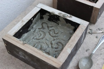 I proceeded very carefully to fill the molds up with concrete, making sure not to damage the prints.